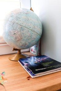 globe and children's math workbook