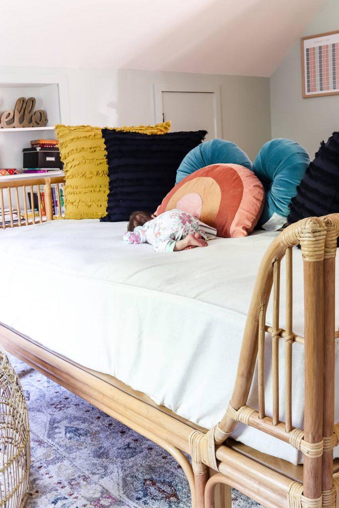baby girl sleeping on World Market rattan bed