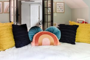 rattan daybed with pillows all the way across teh back