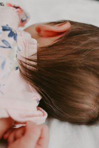 closeup of newborn baby girl with a lot of dark hair