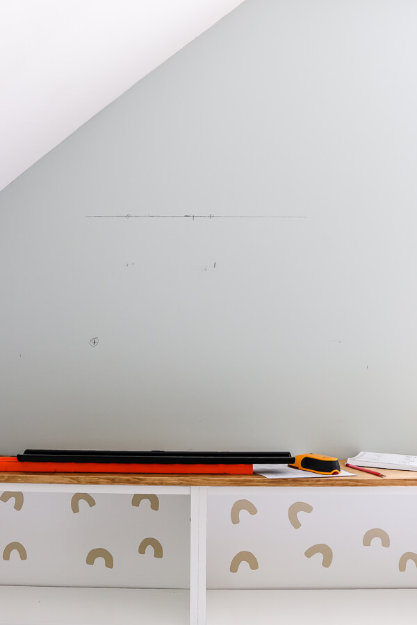 pencil marks on the wall