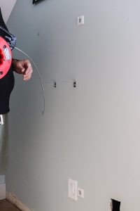 fishing tape from Harbor Freight pulling TV wires through the wall