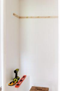 closet wall with wood shelf bracket