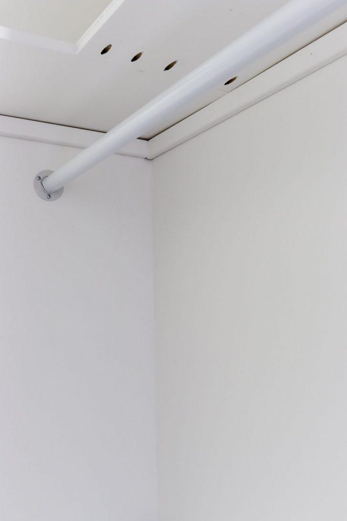 DIY closet shelves shelving unit painted white with white closet rod