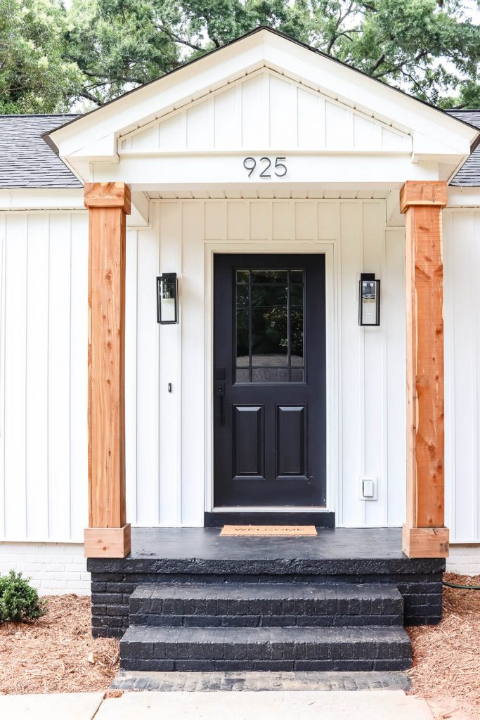 white board and batten siding small front porch