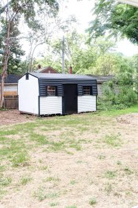 black and white exterior storage shed