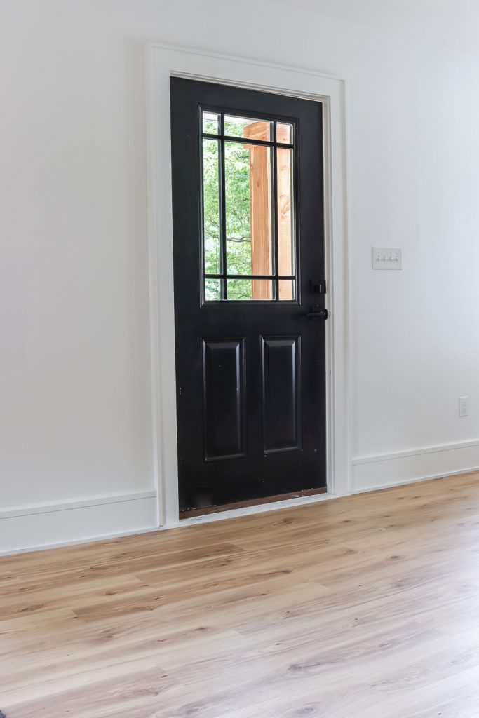 Sherwin Williams Tricorn Black front door with glass in the upper