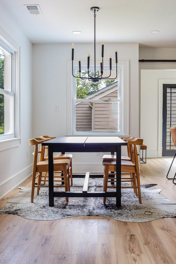 dining nook with black table and wood chairs
