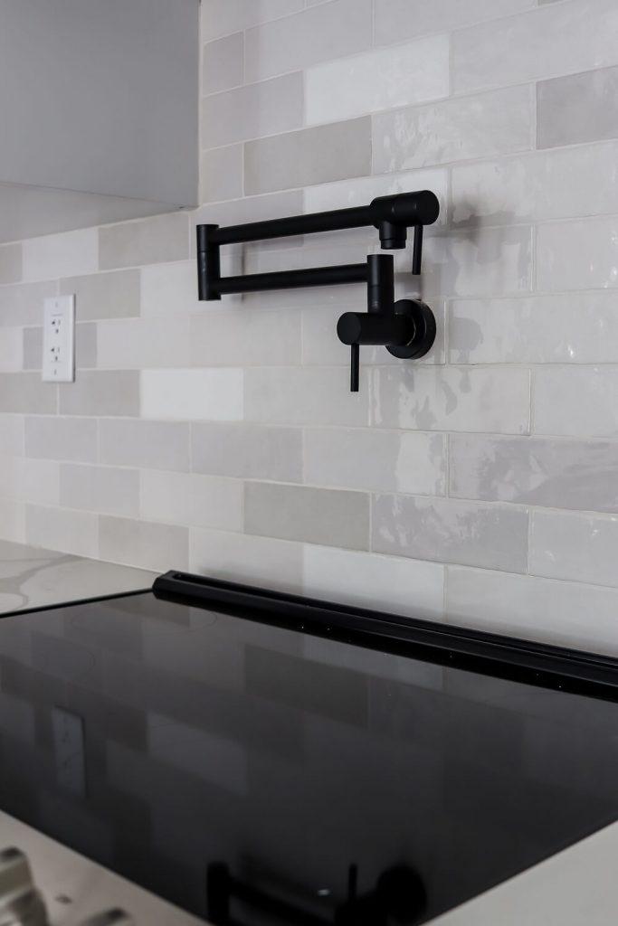 white quartz counters and white cabinets with white beveled subway tile backsplash