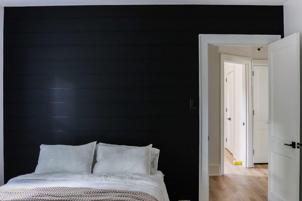 Sherwin Williams Tricorn Black shiplap accent wall in bedroom