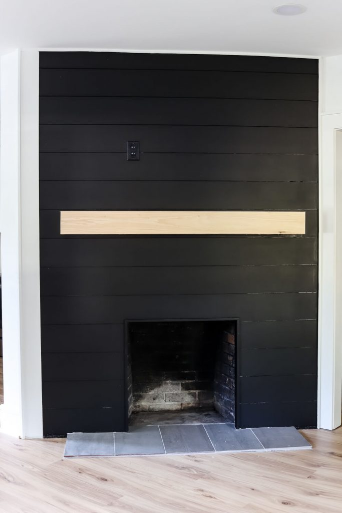 black shiplap fireplace with wood mantle