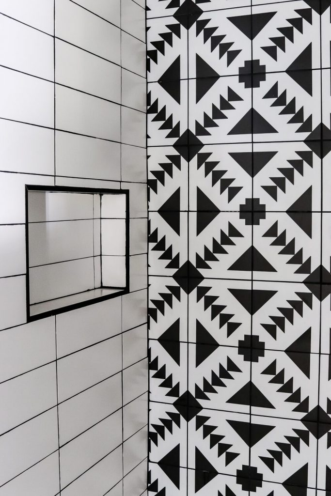 black and white patterned tile in the bathroom with white subway tile