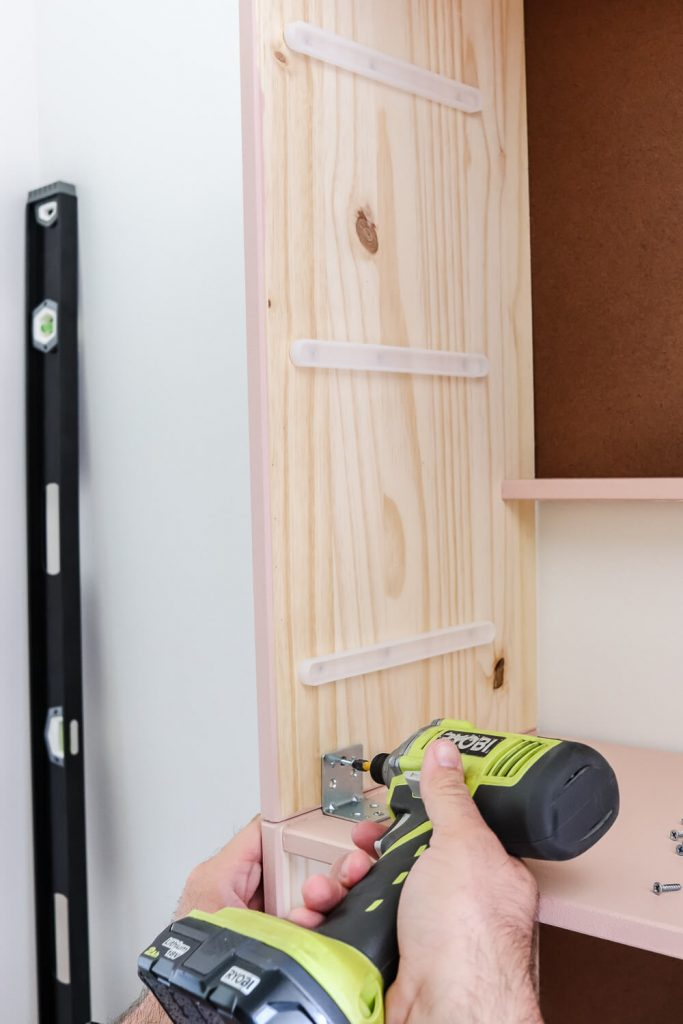 impact driver attaching bracket on Ikea Rast dresser unit