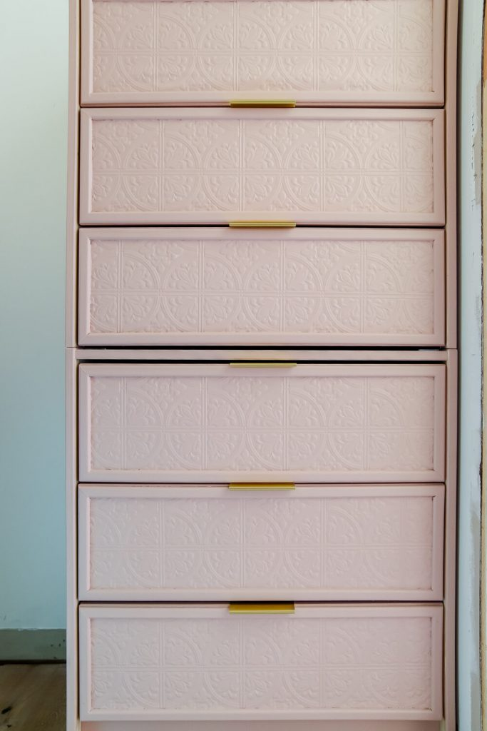 Ikea rast dresser painted in Meet Cute from Clare Paint with paintable wallpaper with gold drawer pulls