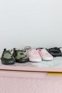 baby shoes on top of Ikea Rast dresser