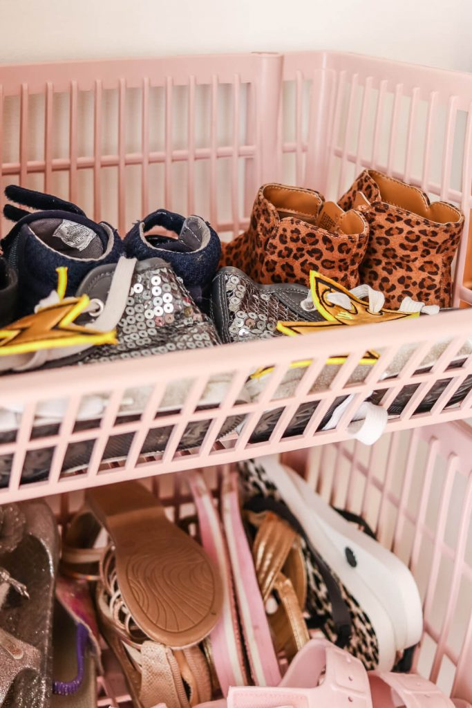 pink baskets from COntainer Store stacked with girls shoes inside of them