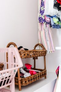 close up detailed shot of rattan storage basket with girls headbands and bows in them