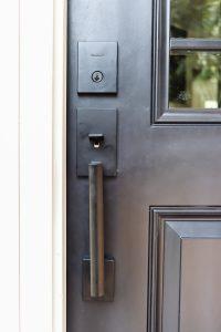 closeup of Kwikset Vancouver with smart key door handle in matte black