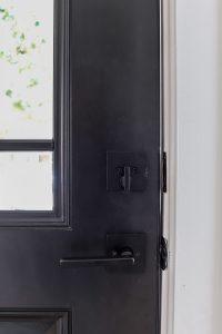 interior side of closeup of Kwikset Vancouver with smart key door handle in matte black