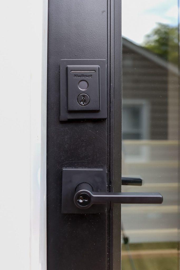 closeup of Kwikset matte black smart lock wifi enabled thumbprint
