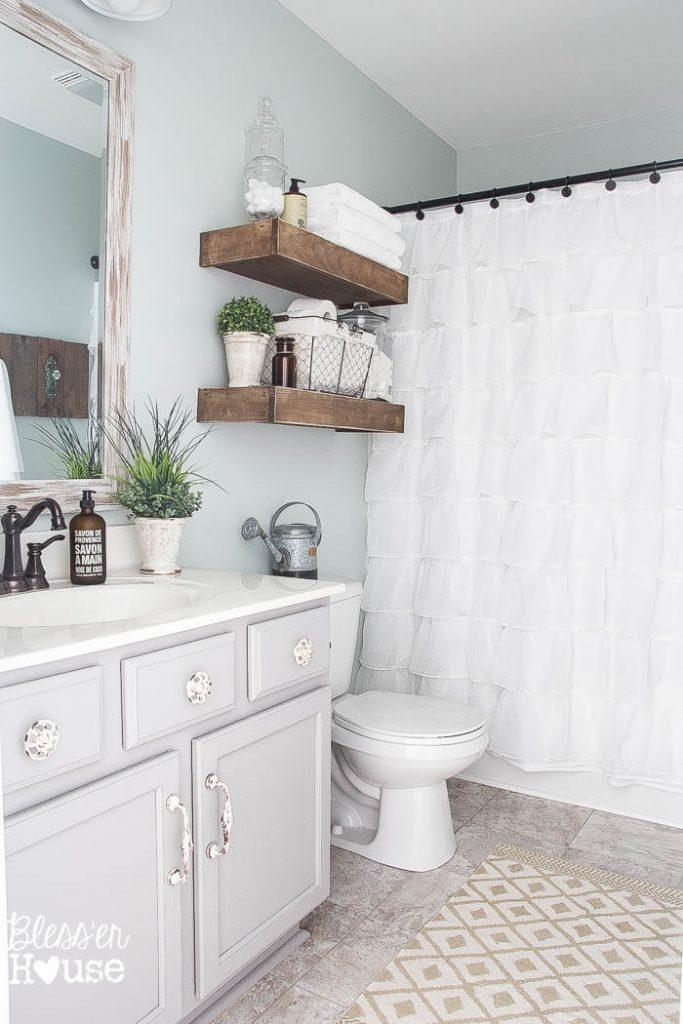 farmhouse bathroom with gray vanity and Sherwin Williams Sea Salt