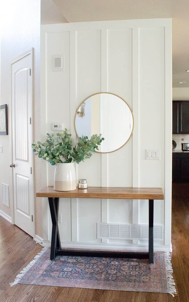 Benjamin Moore Chantilly Lace wood accent wall with wood console table in front of it