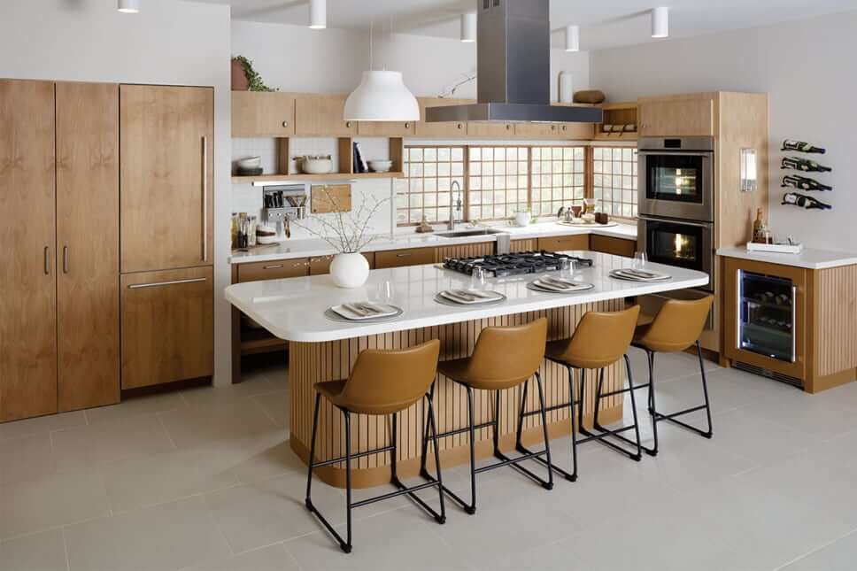 Japandi style designed kitchen with wood cabinets and white countertops