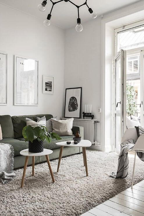 Scandinavian style with green couch and minimal white and wood furniture