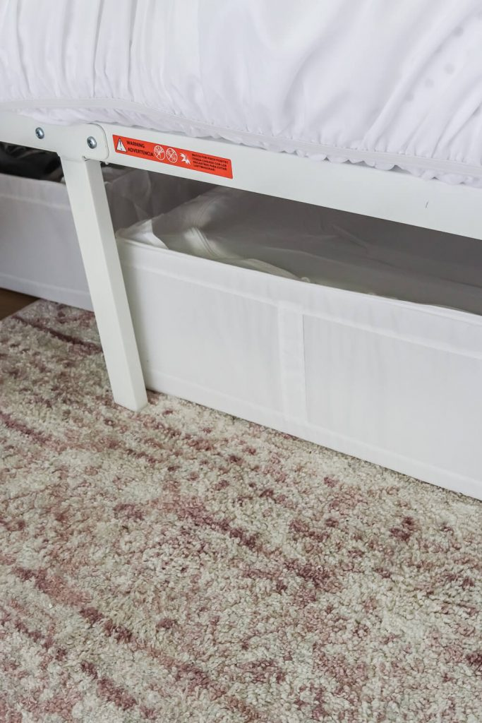 pink rug with white underbed storage container from Ikea