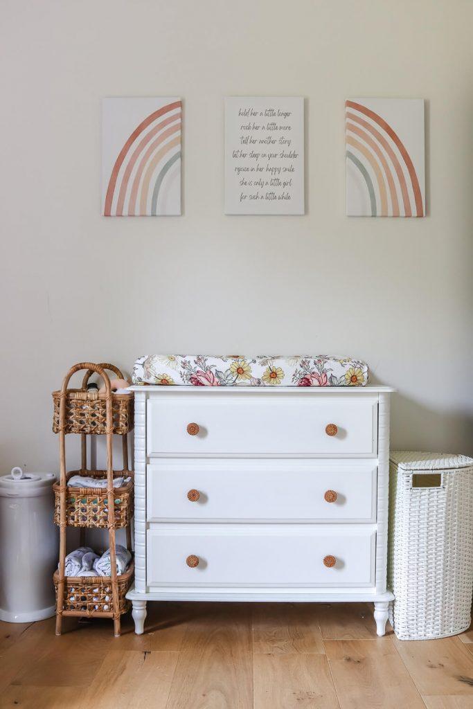 white nursery dresser with rainbow art above