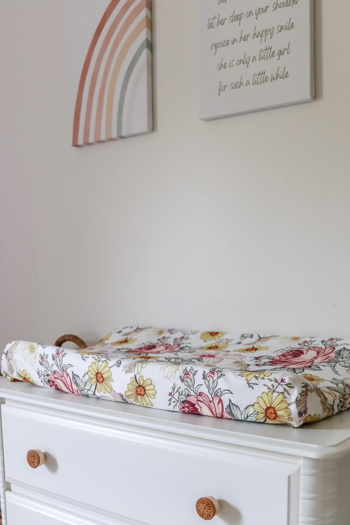 closeup of changing table with floral changing pad