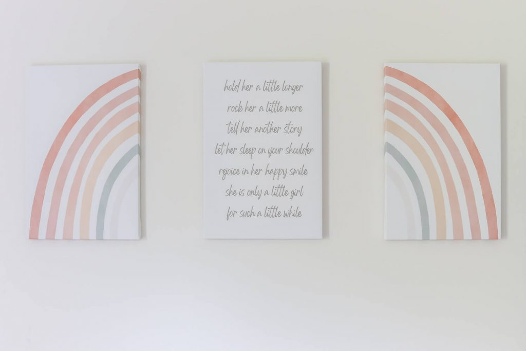 split rainbow artwork and saying in the middle