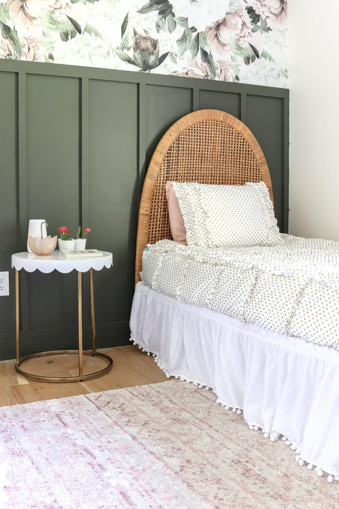 white and gold Beddy's bedding with white bedskirt and rattan vintage headboard