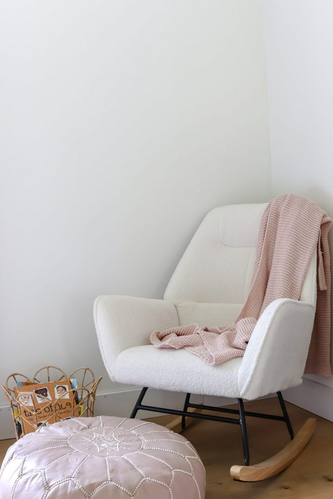 white modern sherpa rocking chair with pink throw