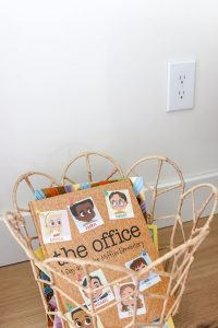 woven basket with children's books in it with The Office Elementary school book on top