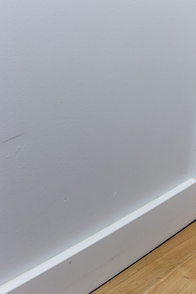 white crafstman style trim baseboards with white oak floors