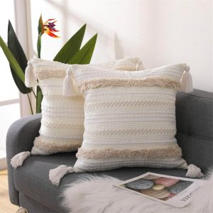 white and cream pillow covers with tassles