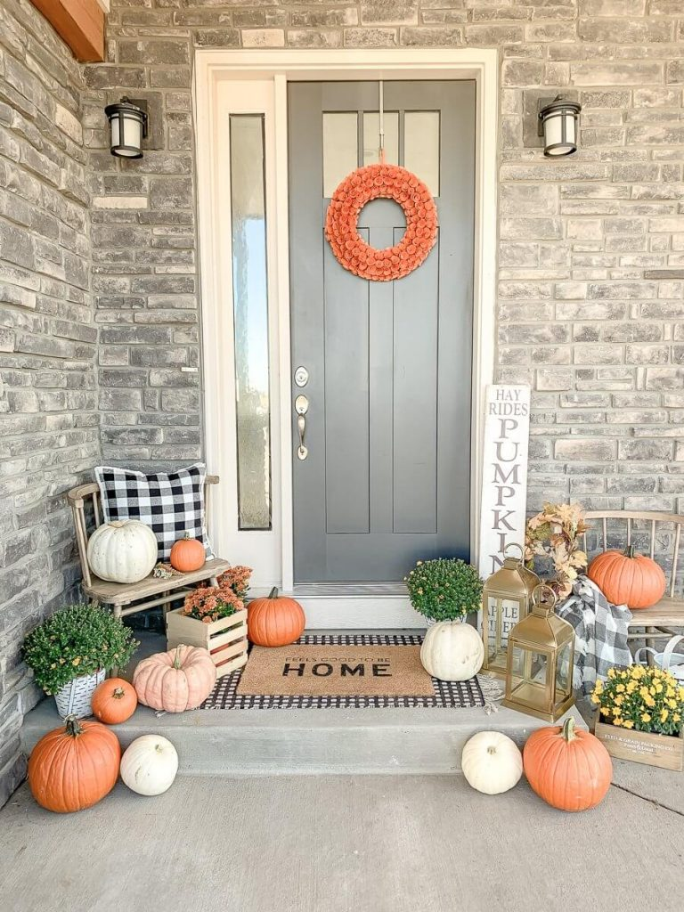 small front porch decorating ideas for fall with pumpkins and small wreath