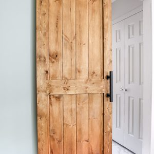 DIY sliding barn door hanging up
